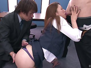 Asian hottie gets her pussy pleasured by two guys in the office